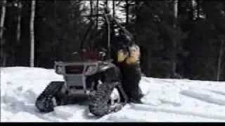 Snow waist deep, four wheeler ATV tracks keeping it on top Thumbnail